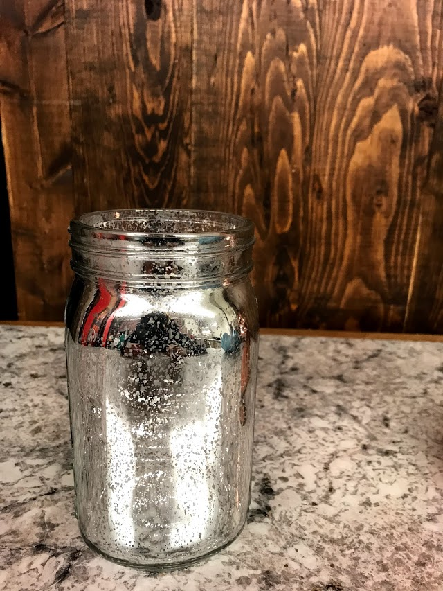 silver metallic jar