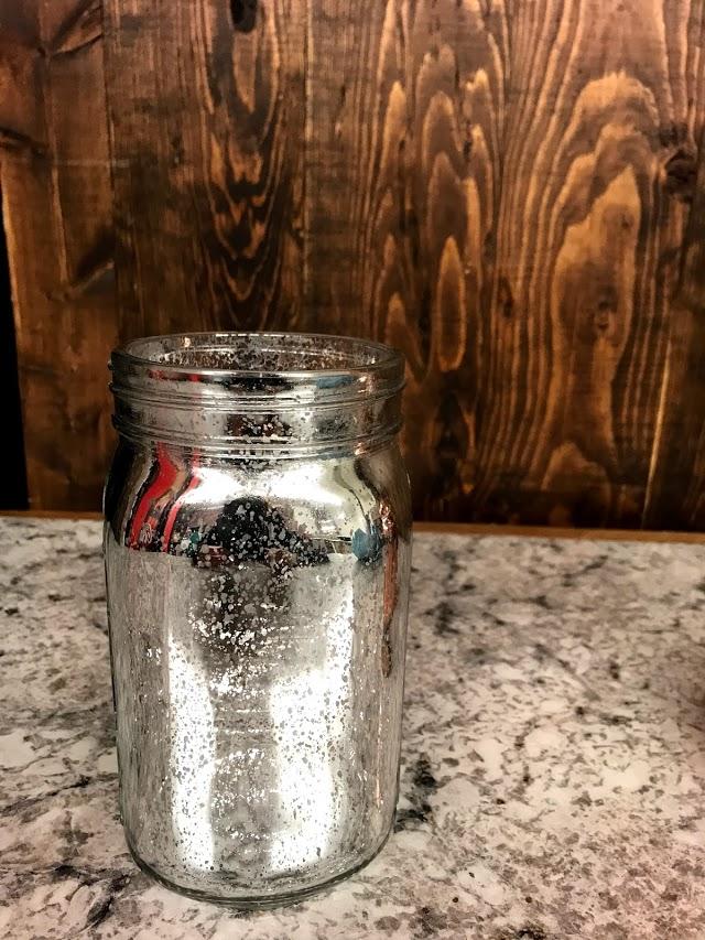 silver metallic jar